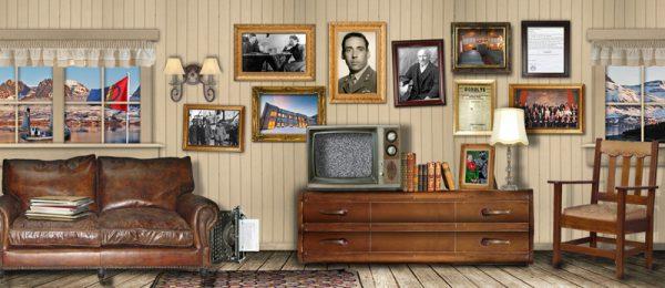 Vegg med bilder. Tv, bord og bøker.